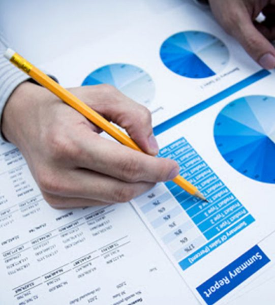 Finances Saveing Economy concept. Female accountant or banker use calculator.